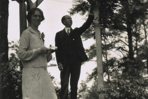 Chestina and Christian Welty standing under the garden arbor, 1920s.