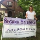 Maggie Stevenson with second Saturdays sign